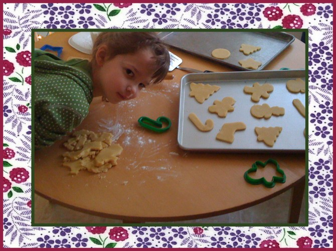 jocelyn making sugar cookie cutouts