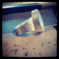 Stamped ring shank soldered on - side view