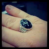Completed ring with snowflake obsidian stone set into place